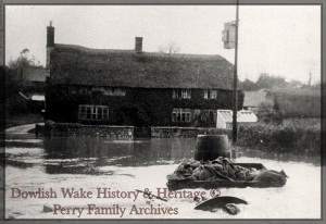 Lower Farm with cart in flooded ford. [Dower House]